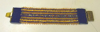 beaded cuff bracelet with leather trim and brass clasp